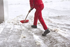 Worker removes snow Stock Image
