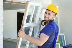 Worker removing old window. In flat royalty free stock photos