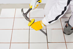 Worker removing white tiles Royalty Free Stock Images