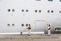 Worker renovate the ship's side Stock Image