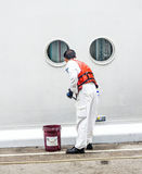 Worker renovate the ship's side Royalty Free Stock Images