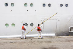 Worker renovate the ship's side Royalty Free Stock Photo