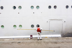 Worker renovate the ship's side Stock Photos