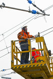 Worker repair the catenary in the station Royalty Free Stock Image