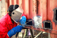 Worker repair container box by gas cutting and welding, Job, wor Stock Photography