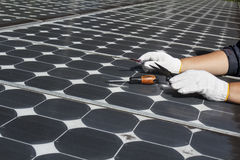 Worker repair energy photovoltaic solar panels Royalty Free Stock Photo