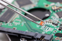 Worker repair green harddisk pcb Stock Photography