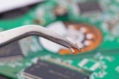 Worker repair green harddisk pcb Stock Photo