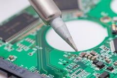 Worker repair green harddisk pcb Royalty Free Stock Image