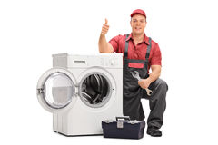 Worker repairing broken washing machine Royalty Free Stock Photos