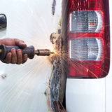 Worker repairing car body after the accident. royalty free stock photography