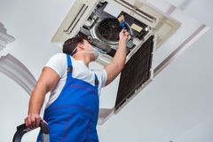 The worker repairing ceiling air conditioning unit royalty free stock photos
