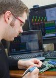 Worker repairing computer equipment Stock Images