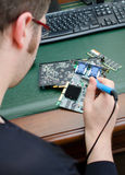 Worker repairing computer equipment Royalty Free Stock Images