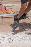 Worker repairing and drilling concrete road. Worker repairing and drilling the concrete road Stock Images