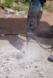 Worker repairing and drilling concrete road Stock Photos