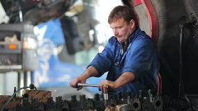 Worker repairing the engine of the truck stock footage