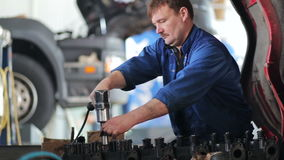 Worker repairing the engine of the truck stock video footage