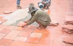 Worker repairing floor Stock Images