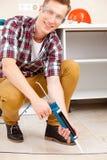 Worker repairing the floor Stock Photography