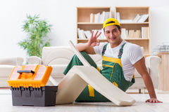 The worker repairing furniture at home Royalty Free Stock Image