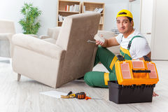 The worker repairing furniture at home Royalty Free Stock Photography