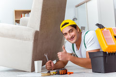 The worker repairing furniture at home Royalty Free Stock Photos