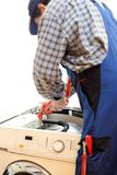 Worker is repairing a machine royalty free stock images