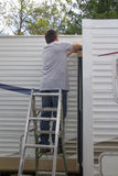 Worker repairing mobile home Stock Images