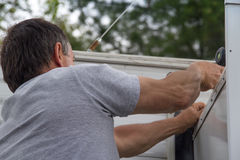 Worker repairing mobile home Royalty Free Stock Image