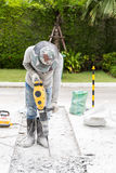 Worker Repairing Road / Worker Drilling Road. Ongoing roadwork under construction using jackhammer equipment Royalty Free Stock Image