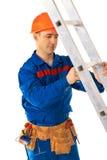 Worker repairing step Stock Images