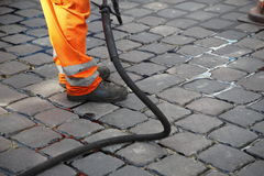 Worker repairing street Stock Image