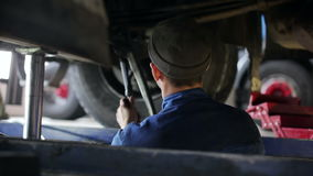 Worker repairing the truck to the service centre stock video footage