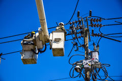 Worker repairing work on electric post power pole Stock Image