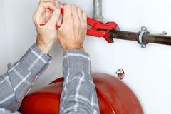 Worker repairs a heating stock image