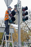 Worker repairs the traffic light Royalty Free Stock Image