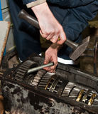 Worker repairs transmission. Mechanic repairs transmission close up Stock Photography