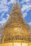Worker repareing golden temple Stock Image