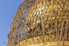 Worker repareing golden temple Stock Photo
