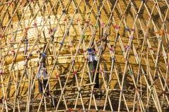 Worker repareing golden temple Stock Photos