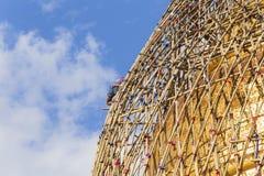 Worker repareing golden temple Stock Images