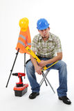 Worker is resting. With equipments and tools on the white background royalty free stock image