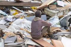 A worker resting after loading up reavation rubble stock image