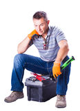 Worker is resting sitting on toolbox Stock Image
