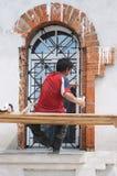 Worker-restorer. Restore window of orthodox church Stock Photo