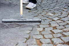 Worker resurfacing cobblestones Royalty Free Stock Photos