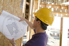 Worker Reviewing Blueprint Stock Photo