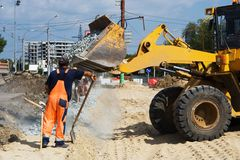 Worker on the road construction Royalty Free Stock Photo