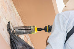 Worker with rock drill the wall Stock Images